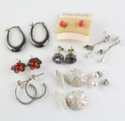 A collection of seven pairs of earrings together with a pair of filigree floral cufflinks