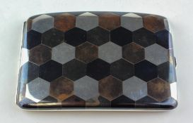 A sterling silver cigarette case, inlaid with various metals in a hexagonal design,