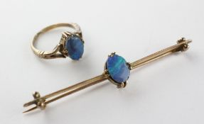 A yellow metal opal doublet single stone ring together with matching bar brooch.
