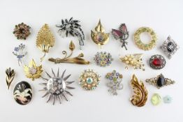 A collection of twenty costume brooches of variable designs.