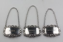 A set of three silver decanter labels, for Port, Whisky and Vodka, maker's mark WA, Birmingham 1970,