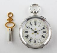 An open face mid size pocket watch. Circular white dial with roman numerals and gold embellishments.
