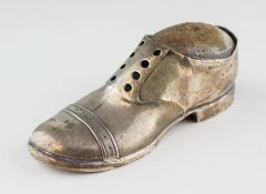 A silver novelty pin cushion in the form of a shoe, Makers mark SE&S Ltd, Chester 1909,
