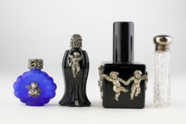 A collection of four silver mounted glass scent bottles, mainly early 20th century,
