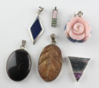 A collection of six pendants of variable designs. Four are marked 925 for silver.