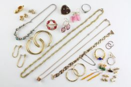 A collection of costume jewellery to include two rings, two necklaces, thirteen pairs of earrings,