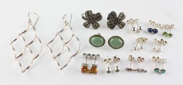 A collection of twelve pairs of silver earrings of variable designs. Some are marked for silver.