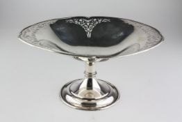 A George V silver comport, the oval bowl with foliate pierced border, maker's mark HA,