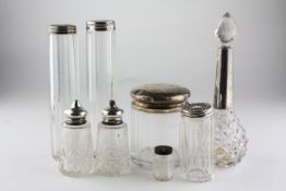 A collection of silver capped glass dressing table bottles and two salts,