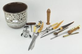 A collection of corkscrews and carving knives,
