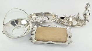 A collection of assorted silver plated wares, including a cruet set, sugar castor,