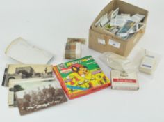 A group of assorted items, including cigarette cards,
