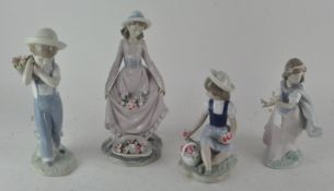 A collection of Lladro figurines, including a boy holding a bag of flowers 27745,