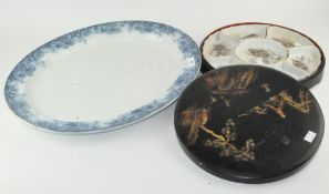A Japanese lacquered box containing porcelain condiment dishes;