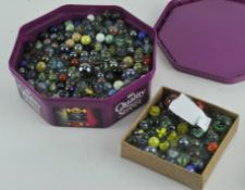 A collection of approximately 550 marbles of varying sizes and designs