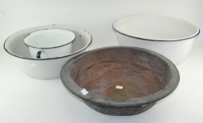 An enamel chamber pot together with two large enamel basins and a metal example,