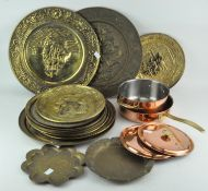 A collection of brass and other metal trays, including examples with hammered decoration,