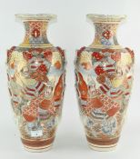 A pair of Japanese satsuma style vases depicting traditional scenes,