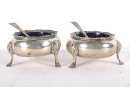 A pair of early Victorian silver open salts in the cauldron form, each raised upon three feet,