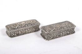 Two silver snuff boxes, of rectangular form, embossed overall with scrolls within frilled rims,