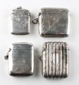 A selection of four silver vesta cases, including an example of ribbed cylindrical form,