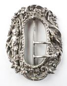 An ornate late Victorian silver belt buckle,