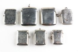 A selection of seven silver vesta cases, each of varying shape and design,