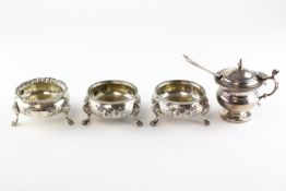 A pair of Victorian silver open salts of cauldron form, raised upon three lion paw feet,