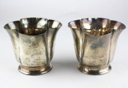 A pair of late Victorian silver cups of fluted form on pedestal style base, hallmarked London 1900,