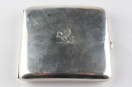 An Edwardian silver cigarette case of square form, opening to reveal gilt interior,