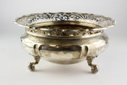 A large early 20th century silver bowl, raised upon three scrolling feet,
