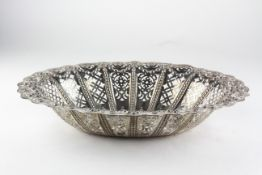 A late Victorian silver basket of oval form, decorated throughout with pierced and embossed motifs,