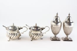 A pair of Edwardian silver mustard pots,