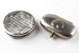 A George V silver plated dual Sovereign case, the lid adorned with a heart motif,