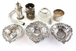 A collection of various silver items, including three pierced dishes, a walking cane handle,