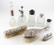 A silver and white-metal mounted dressing table set, including brushes, atomiser,