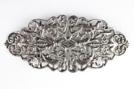 A large late Victorian silver buckle decorated with cast and pierced leaf and flower head design,