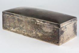 A Victorian silver cigarette box of rectangular form, hallmarks rubbed, 18cm wide,