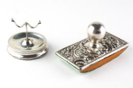 An Edwardian silver ink blotter, adorned with embossed decoration, hallmarked Birmingham 1904,