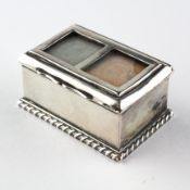 An Edwardian silver double stamp box of rectangular form with rope effect border,