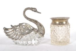 A silver mounted cut glass novelty bon bon dish in the form of a swan with articulated wings,