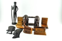 A group of carved African figures, 38cm high; heads, treen, a truncheon,