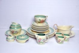 A Susie Cooper part service in the 'Patricia Rose' design (cup and two saucers);