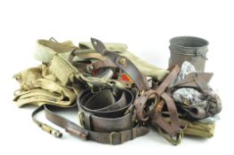 A group of military items, including webbing, a leather belt,
