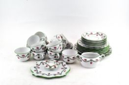 A Continental porcelain tea service printed with pink roses and green husk swags,