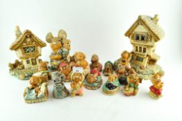 A collection of Pendelfin rabbit figures and houses,
