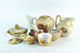 A collection of Royal Worcester porcelain, predominately blush ivory ground and flowers,