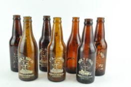 A collection of vintage brown glass beer bottles - Holt's of Burnham,