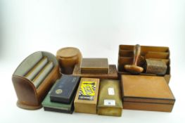 A group of cigar boxes and desk tidies, including engraved brass, tin and lnlaid boxes,