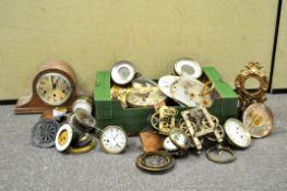A box of clock movements and parts,